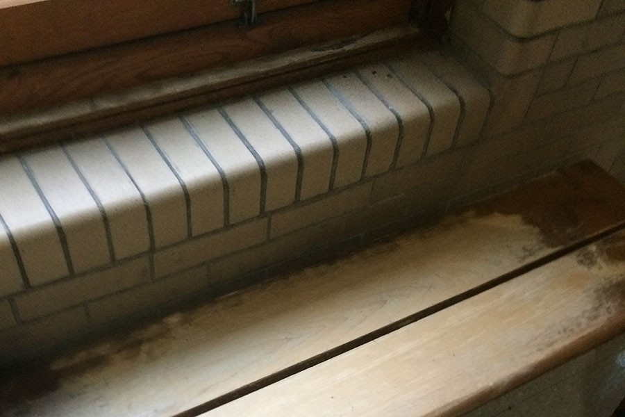 A student wrote a threat on this dance room bench last night. Custodians sanded the bench to remove the graffiti. Principal James Reed informed the school of the threat via P.A. announcement at 9:57 a.m. today.
