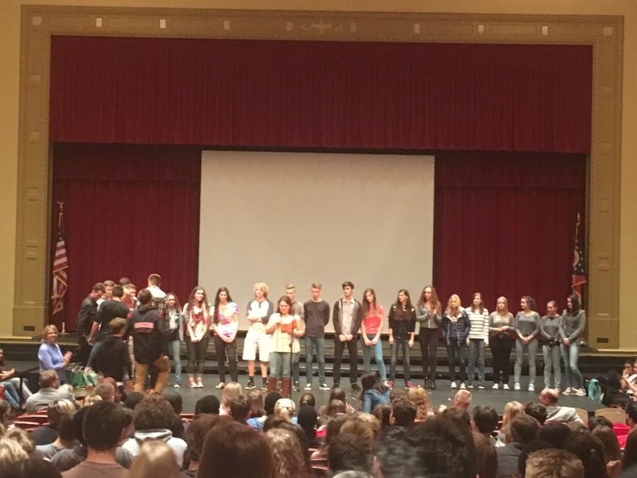 German Club president Carolyn Sindelar introduces the exchange students from Goslar at the assembly Sept. 5.
