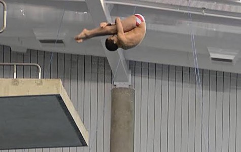 Lyle Yost assumes a pike position in a dive off a 10 meter platform.
