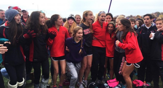 The Women's cross country team reacts after qualifying for states. The Raiders placed fourth at the regional final in Youngstown last Saturday.