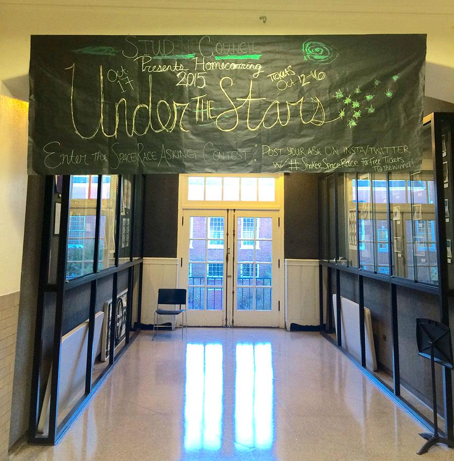 A banner displaying the 2015 homecoming theme hanging in the Ely gallery near the main office Oct. 6.