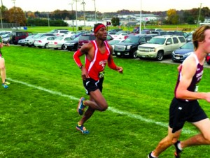 Senior Justyn Moore runs at the Youngstown REgional Meet.