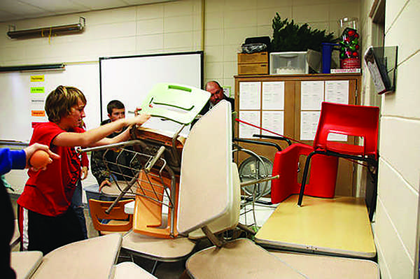 Students at Richland Junior High in Essex, Missouri barricade a classroom door during ALICE training session. Shaker previously considered this  training to teach students how to react to an intruder.