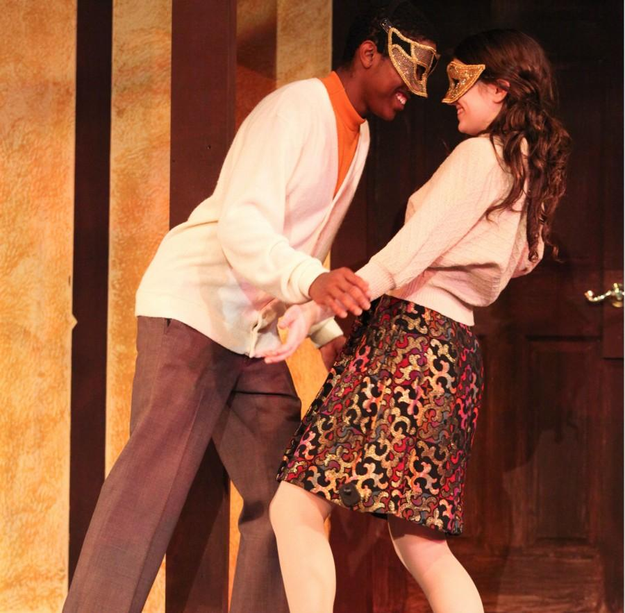 Romeo (Tony Jones) and Juliet (Emily Kenville) first meet at the Capulet's party.