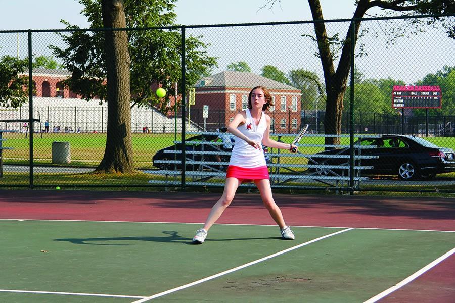 Senior Claire Hummel returns the ball during a match.