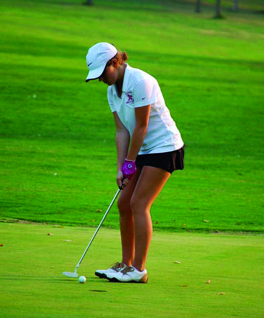 Sophomore Maggie Dant prepares to swing during a tournament.