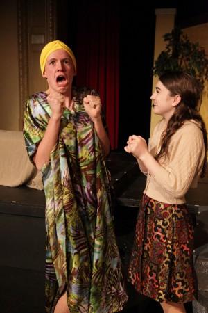 The Nurse (Gus Mahoney) gossips with Juliet.