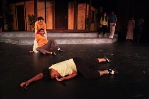Romeo and Benvolio look on at the dead Tybalt (Samira Colbert).