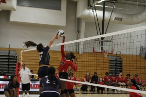 Women's volleyball fights for points in a match against Solon.