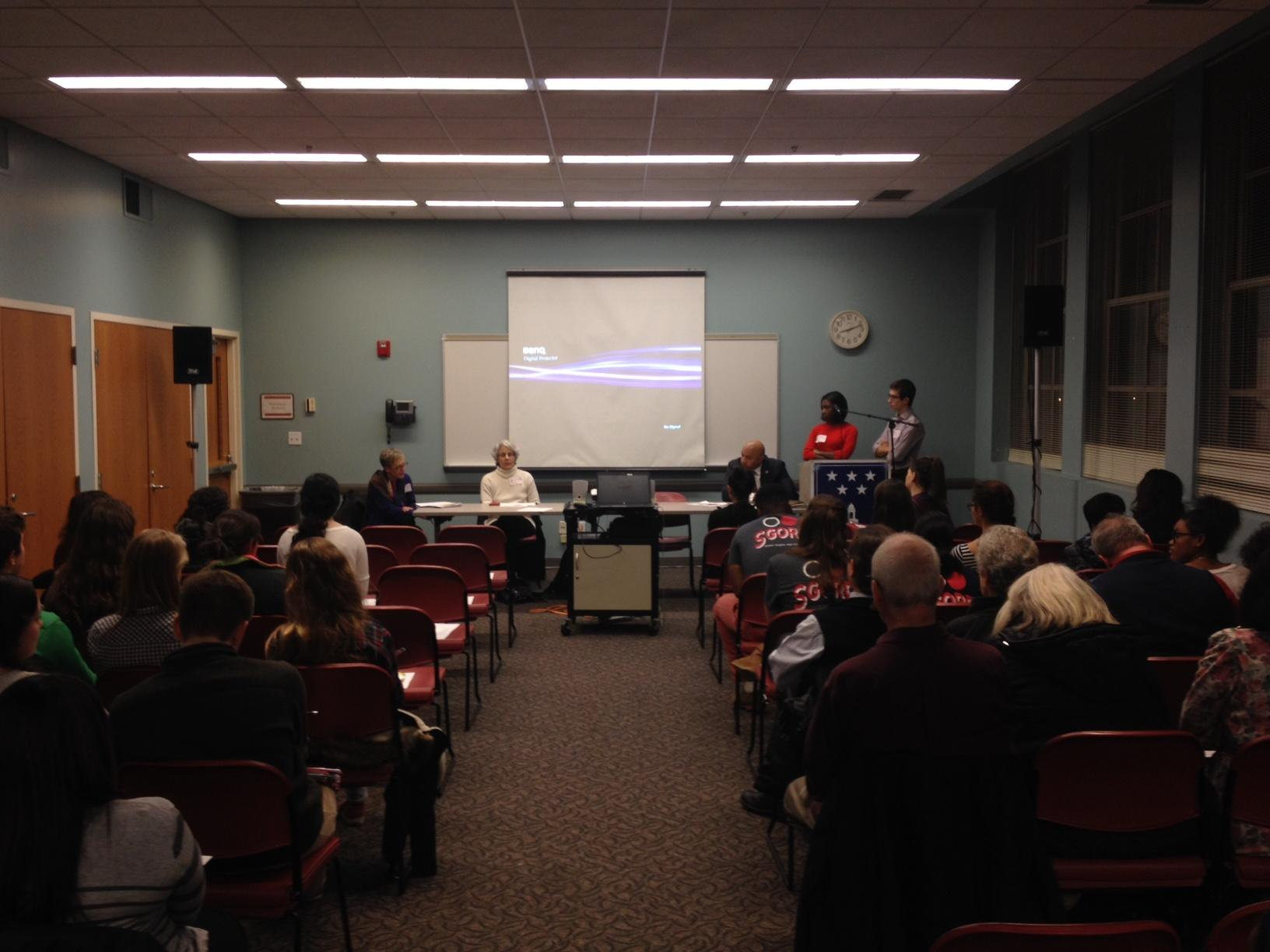 SGORR member Jonah Ricanati reads a question to the panel members on Dec. 3 at the Shaker Heights Main Library.