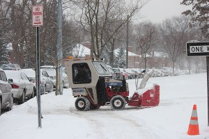 District personnel cleared sidewalks before school this morning.