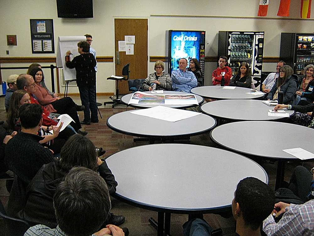 A group discusses one option for a master plan at a previous meeting in the upper cafeteria.
