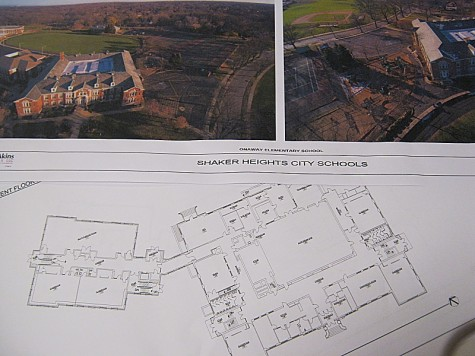 Blueprints and aerial photos of Onaway Elementary School lay untouched on cafeteria tables