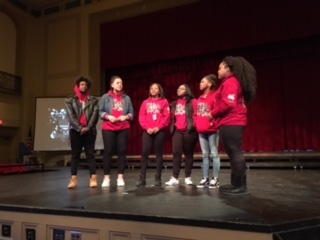 Sankofa members sing a song at the beginning of the second period assembly Feb. 26.