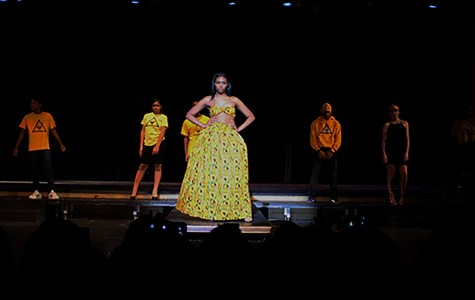 Junior Vance Fleming, freshman Daian Phillips, senior Morgan Owners, junior Phanawn Bailey and junior Britta Nelson modeling yellow outfits from the African-American Cultural Gardens scene.