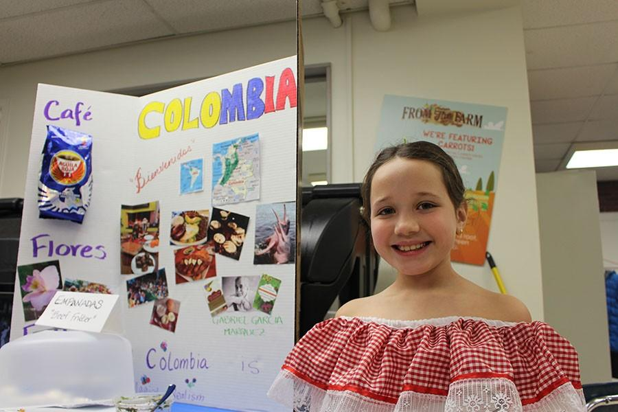 Boulevard+third+grader+Elliana+Williams+stands+in+front+of+her+display+about+Colombia+March+16.+