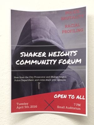 A flyer hangs in the hallway of the high school encouraging students to attend the forum.