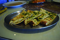 Naan, from Cafe Tandoor in Cleveland Heights, is an Indian flatbread served with many Indian dishes. They offer different types of naan, from garlic to spiced lamb to cashew.
