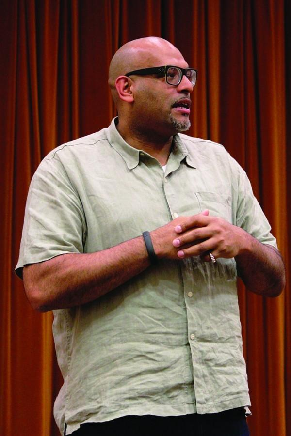 "John Amaechi speaks to Shaker students in the small auditorium Oct. 22, 2014. In 2007, Amaechi, became the first NBA player to come out. He encourages athletes to be themselves, but, he said, ""You can't tell an athlete to come out."""