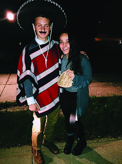 Junior Andrew Roth asked Kristi Seman to homecoming by wearing a sombrero and writing his invitation on a tortilla.