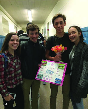 Freshman Caroline Kiker and Caroline Wollman asked Trent Meyer and Nathan Murray to winter formal by writing a gum-inspired pun on a poster.