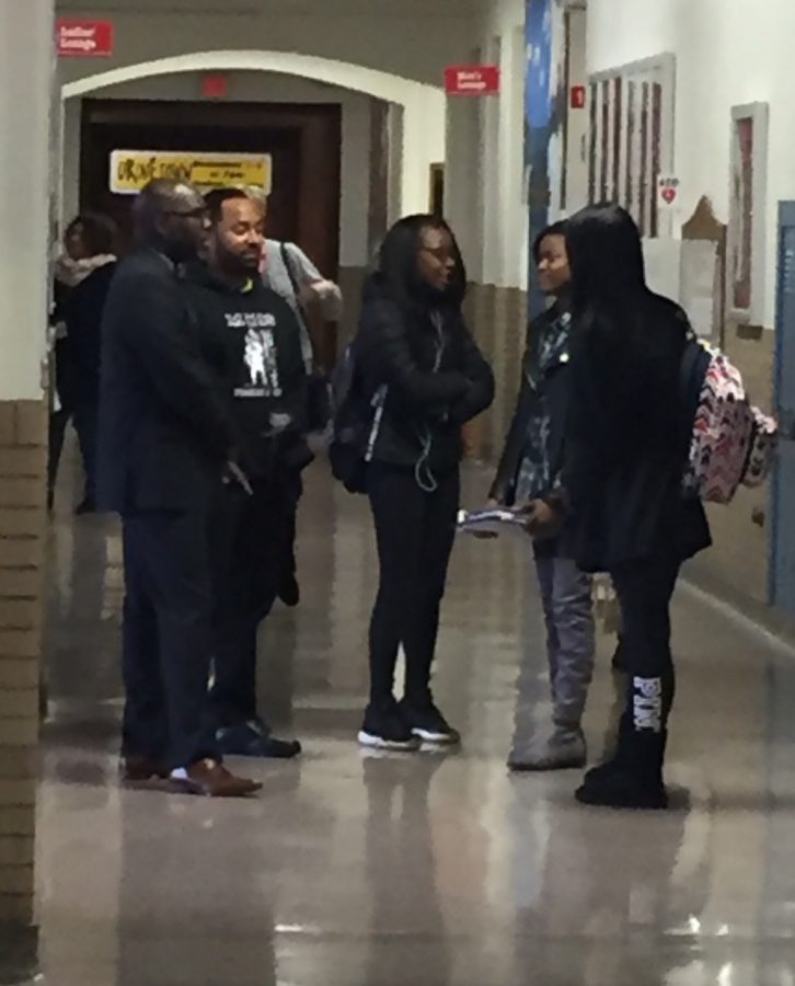 Superintendent Gregory C. Hutchings talks to students in the hallway Friday, Nov. 11.