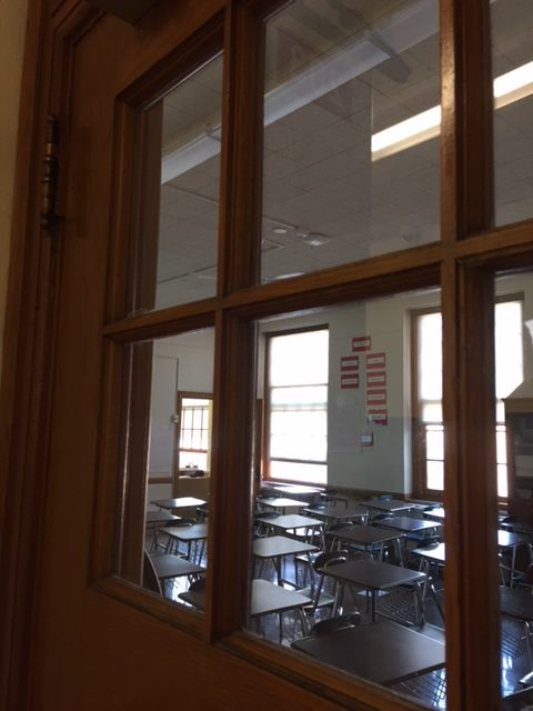 A high school classroom sits empty during school hours.