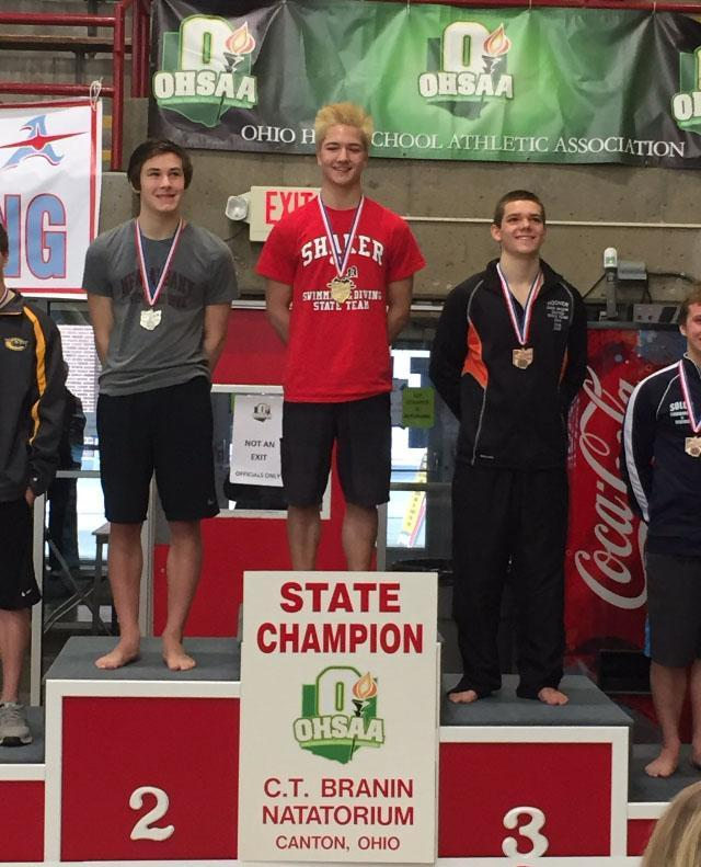 Sophomore+Lyle+Yost+%28middle%29+won+his+first+state+championship+on+Feb.+25+after+finishing+second+in+the+previous+season.+