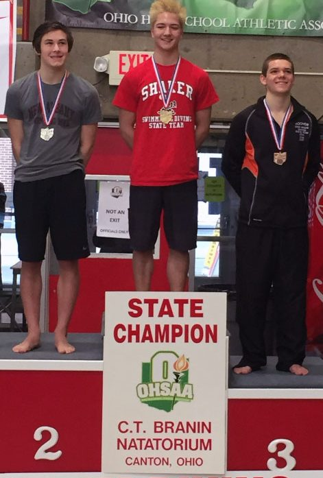 Sophomore Lyle Yost (middle) won his first state championship on Feb. 25 after finishing second in the previous season.