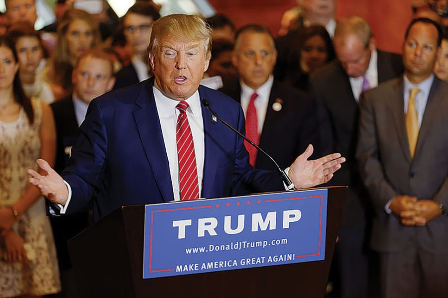 "President Donald Trump speaks in Trump Tower at the beginning of his presidential campaign. In his first month of his presidency, Trump has described mainstream media outlets such as the New York Times as ""fake news."""