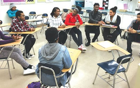 "Members of the high school's chapter of the NAACP engage in discussion in Room 157. ""Through the [NAACP's] Race and Culture Committee, we'll be doing different discussions and different activities, maybe even field trips, based around bringing racial and cultural awareness,"" said Siraj Lee, senior and NAACP leader."