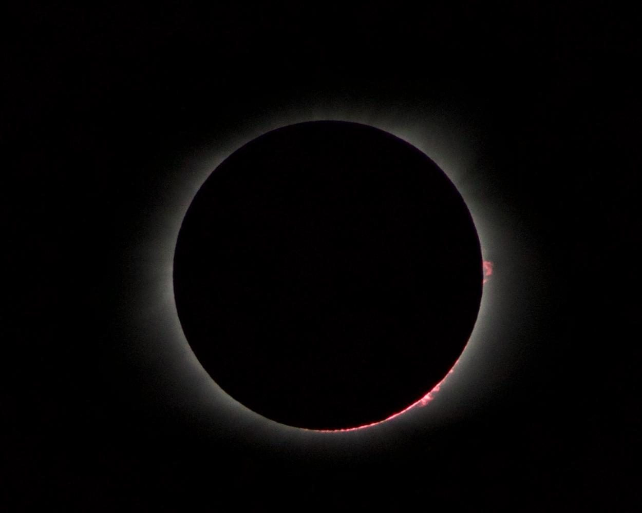 The moon blocks out the sun during a total solar eclipse.
