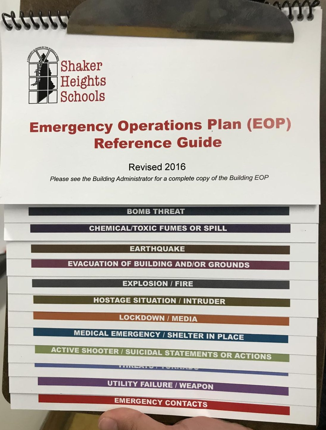 "An emergency operations plan guide hangs on the wall, detailing procedure for different emergency situations. ""We did take into consideration how soon to do it after the mass shooting,"