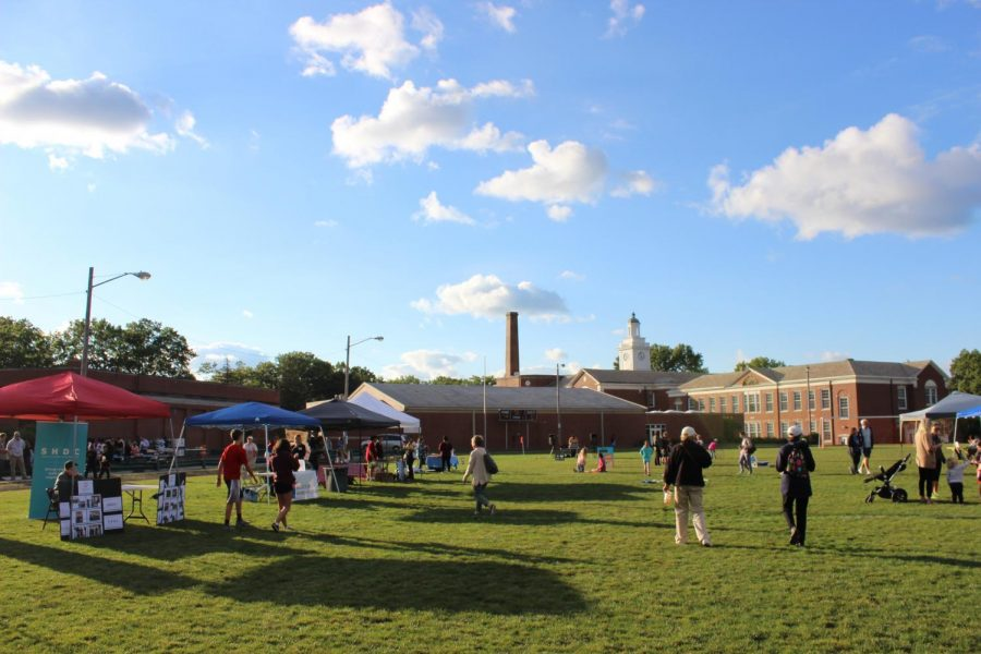 Tents of Shaker organizations stand on the field behind Onaway and Woodbury as children play around them. The next CommUnity Market is planned for Oct. 26, and will look largely the same.