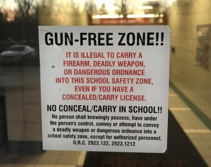 A+%22Gun-Free+Zone%22+sign+hangs+in+a+window+at+the+front+entrance+of+the+high+school.+%E2%80%9CThink+how+often+cell+phones+go+missing+or+get+stolen.+Is+it+always+possible+to+secure+every+piece+of+property+in+our+building+24%2F7%3F%E2%80%9D+said+Principal+Jonathan+Kuehnle.