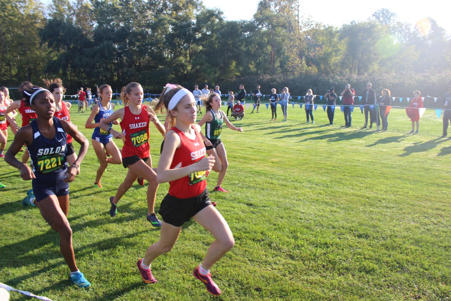 Cross country senior Sophie Carrier leads the pack at the conference meet Oct. 14.