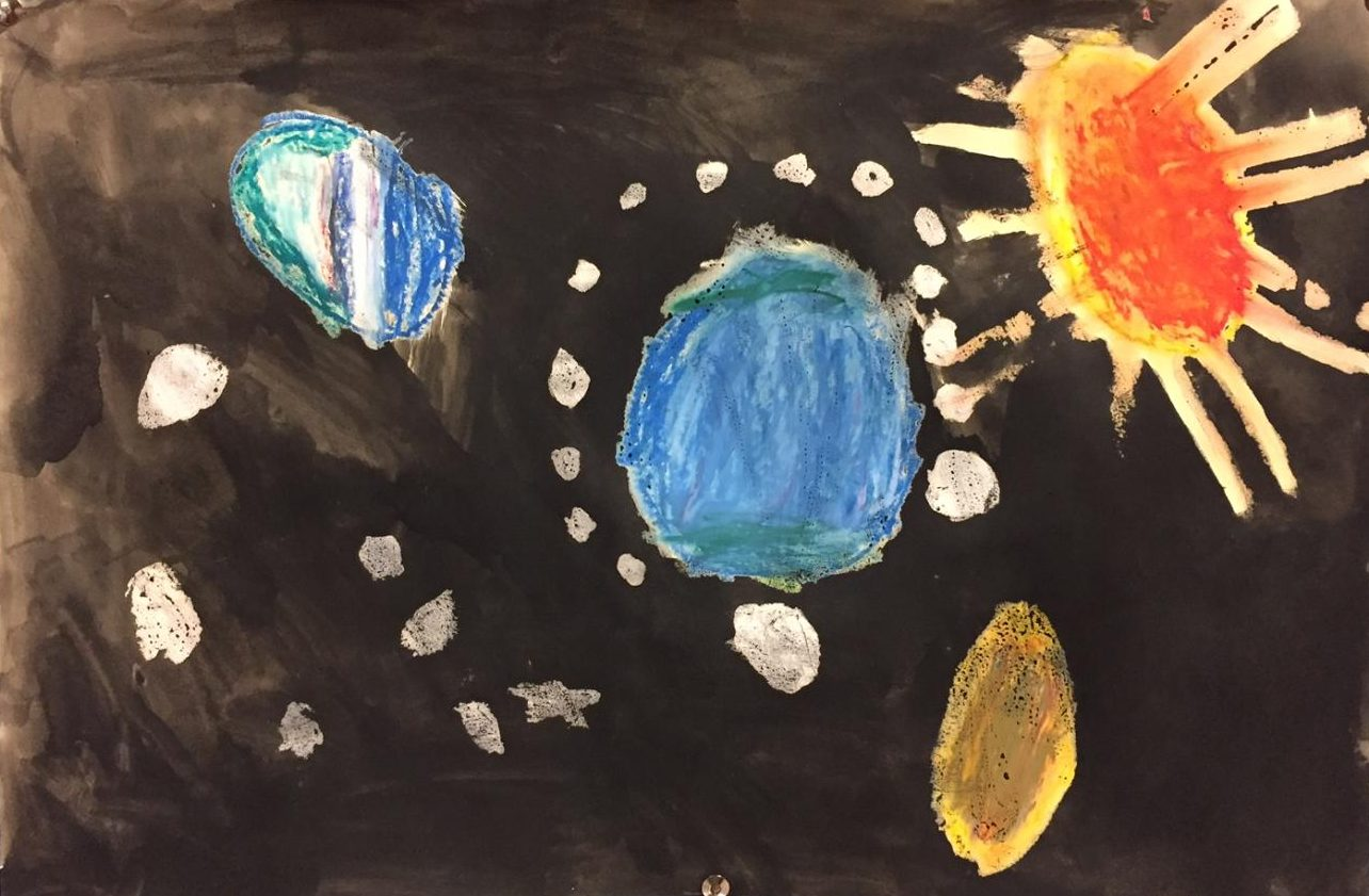 Elementary school students painted pictures of space that were displayed outside the large auditorium.