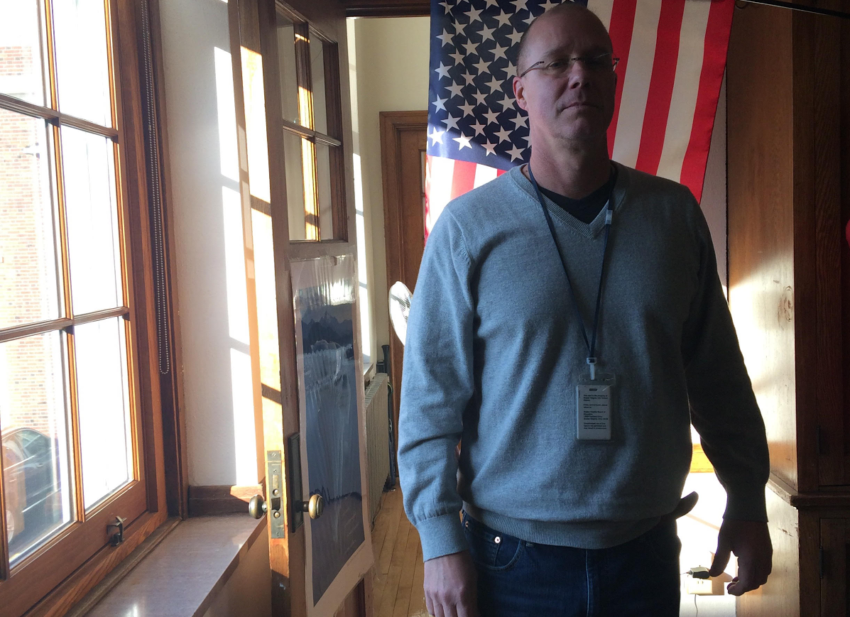 Tod Torrence, Army veteran and history teacher, in front of his classroom's American Flag.
