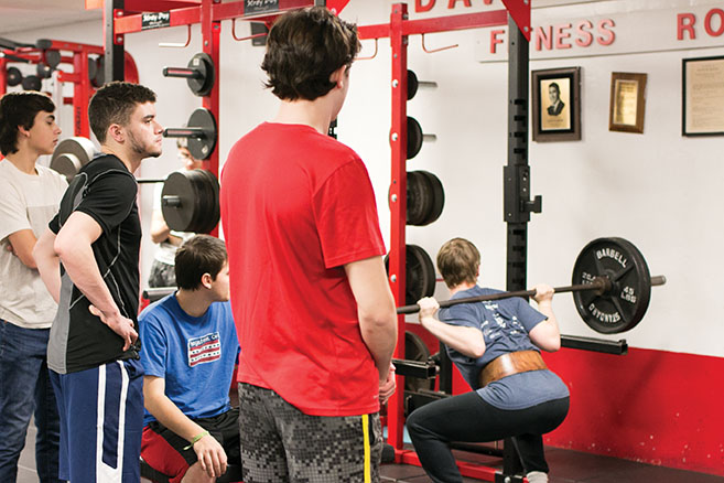 Senior Daniel Crouse back squats during zero period Weight Training Jan. 25.  Thirty people are currently enrolled in the class.