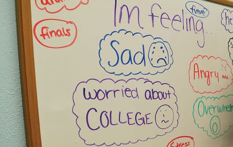 "A white board in the zen room displays feelings students have written.  ""Teachers know that if they find something in writing, or if they hear something, they need to let someone know right away. And they do — and they've saved lives,"" school nurse Paula Damm said."