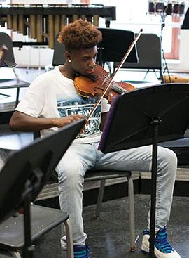 Freshman Dejonte Lawrence practices violin.