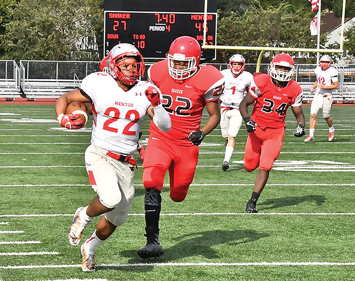 The News-Herald Mentor's Elijah McDougal carries during the Cardinals' victory over Shaker Heights on Oct. 7.