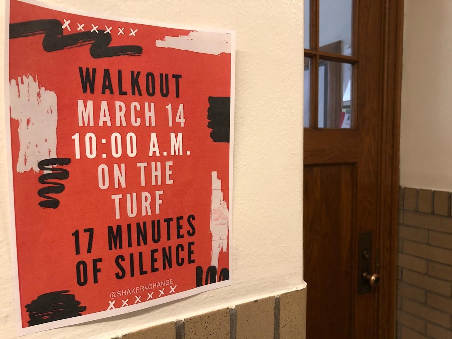 Posters hang throughout the high school advertising a student-led, student-organized walkout that will take place tomorrow at 10 a.m. Participating students will walk to the high school's turf field at Russell H. Rupp Stadium and observe 17 minutes of silence in memory of the 17 victims of the Feb. 14 Marjory Stoneman Douglas High School shooting.