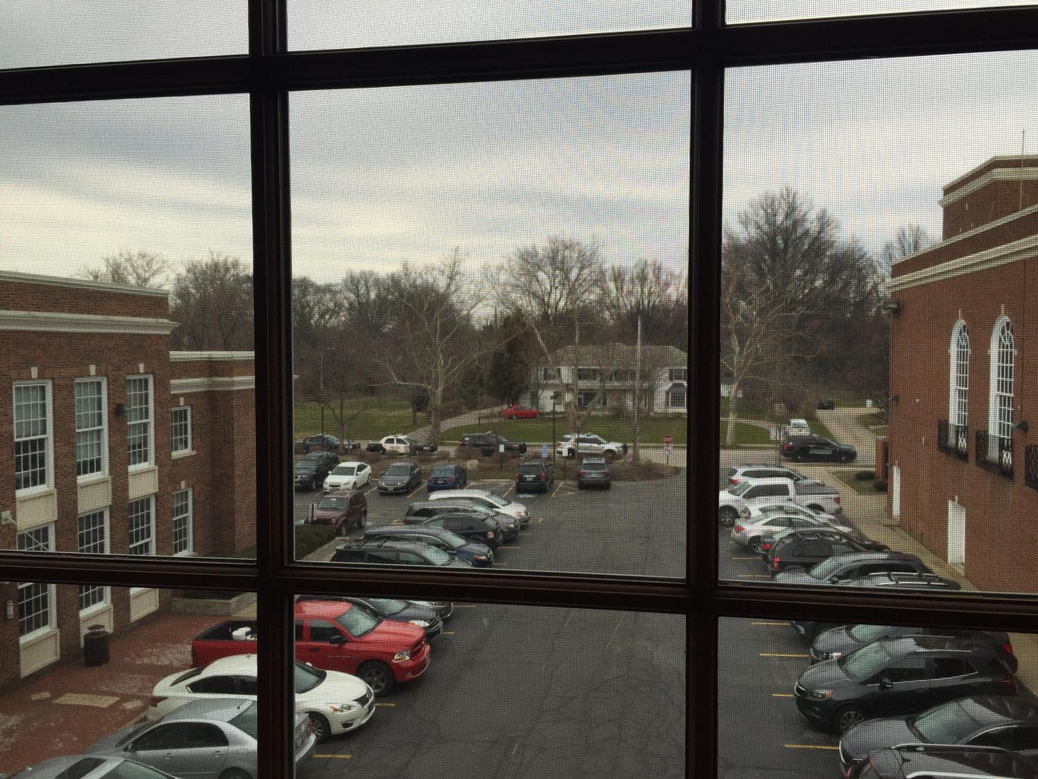Police cars could be seen outside a window in the high school during a