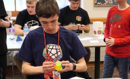 "Lewicki solves a megaminx puzzle at a Shaker Heights cubing competition. ""I practice all day at every possible moment,"" Phillip said. ""I want to break the world record in at least one event. I want to be competing for world championship podiums for my main events."""