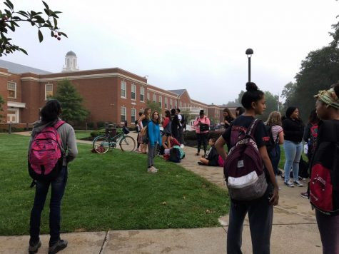 Students waited outside the high school after evacuating early this morning.