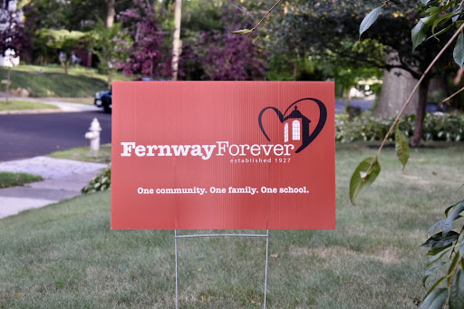 Neighbors who support of reopening Fernway Elementary School boast their 'Fernway Forever' signs, which line the streets of the neighborhood.