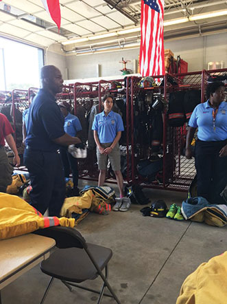 Izzy waits to put on her gear alongside her classmates at Tri Heights Fire Tech program. She is the only Shaker student enrolled in the program.