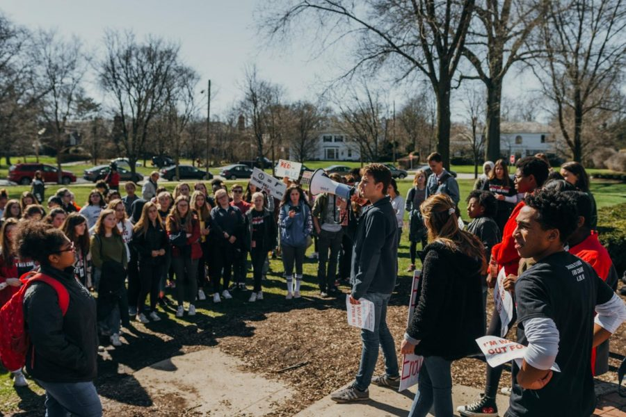 Student+participants+in+the+nationwide+walkout+on+April+20+gather+to+hear+speeches+from+classmates.