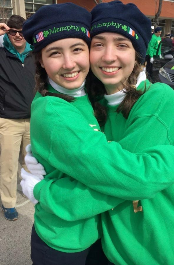 Lupton poses with a friend at the St. Patrick's Day in March 2018. Murphy's Irish Arts Center marches in the parade every year.